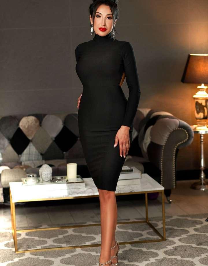 24/7 Central London Escort in elegant black dress - Corina
